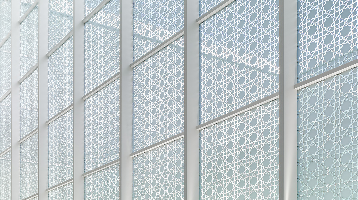 A view of the Aga Khan Museum's patio window walls and the intricate pattern designs within them