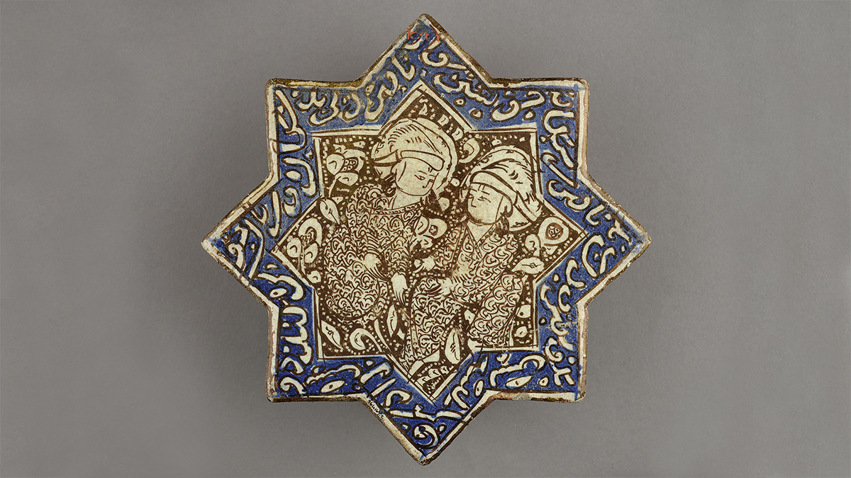 Tile in star form with lustre-painted design of two figures wearing owl-feather hats