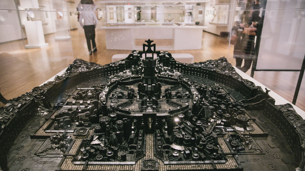 A fortified cityscaped constructed of approximately 100,000 black LEGO piece.