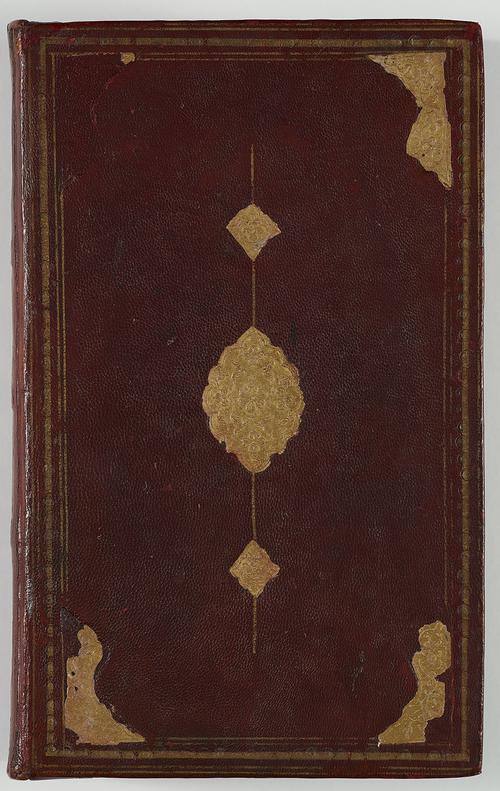 View of the back of a book bound in dark brown leather. There is a border of gold-embossed tooling, with large corner shapes and a central medallion with small pendants. The gold foil is falling off and not complete