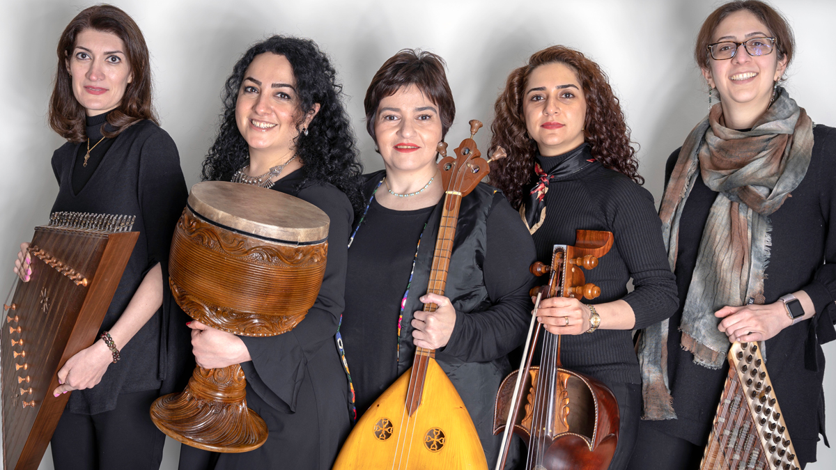 Five women stand with their instruments in this portrait.