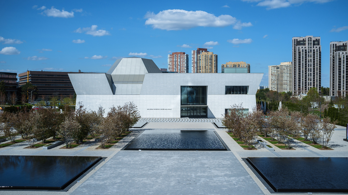 The Aga Khan Museum and Aga Khan Park seen from a distance on a sunny summer day.