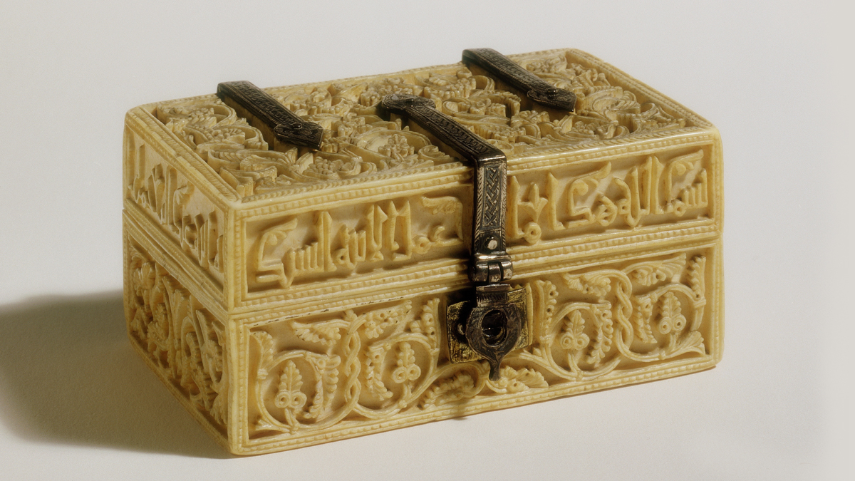 A carved ivory casket with silver mounts and clasps.