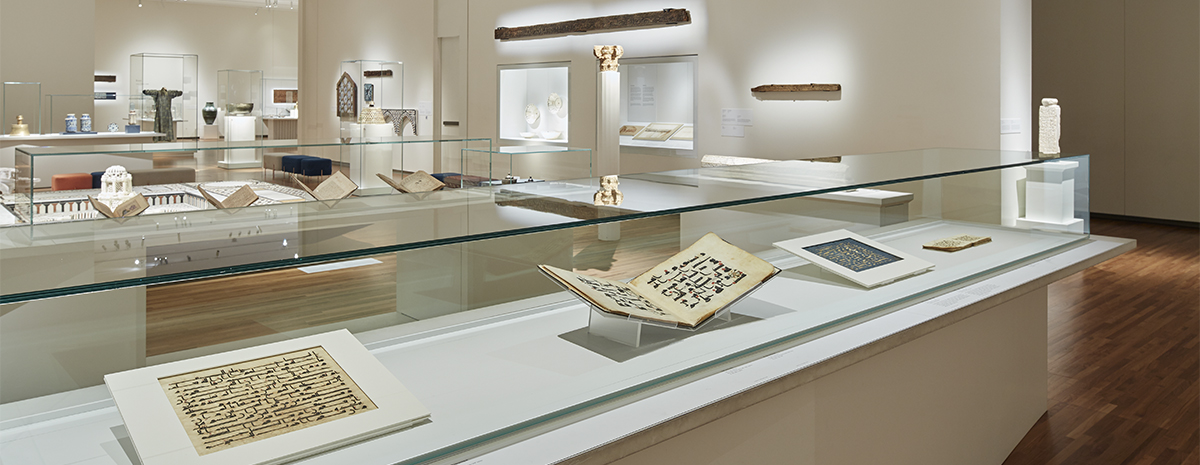 Museum collection gallery, featuring four works on paper in a rectangular Museum showcase with glass top in the foreground.